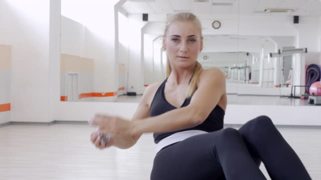 athletic woman intensively exercising with weights on step aerobics - step aerobics stock videos and b-roll footage