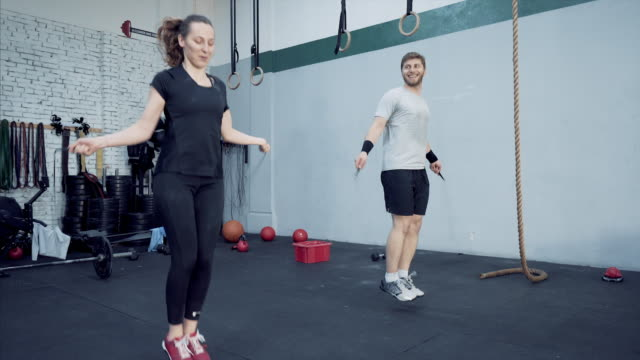 Athletic young couple jumprope workout.