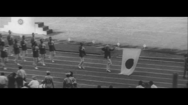 athletics association in two asian games/4th asian ball games opening ceremony japanese athletes japanese athletics association sign interview with... - 1962 stock-videos und b-roll-filmmaterial