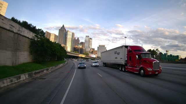 atlanta cityscape and semi truck on interstate 75 on may 31, 2021 at sunset. - pursuit concept stock videos & royalty-free footage