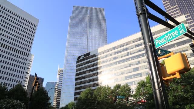 atlanta midtown buildings with peachtree street sign - ローアングル点の映像素材/bロール