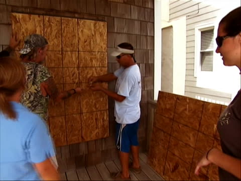 atlantic beach nc on august 26, 2011 65-million americans could feel the wrath of irene in what is expected to be a weekend of violent weather.... - hurricane irene stock videos & royalty-free footage