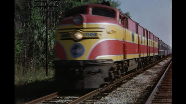 1954 montage atlantic coast line train crossing rural landscape, daytona beach, florida, usa - railroad track stock videos & royalty-free footage