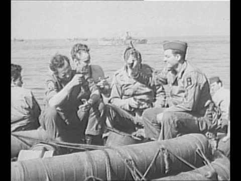 troop ships at european dock; soldiers of the us first army stand on dock waiting to go home now that world war ii is over / soldiers wave from on... - the end stock videos & royalty-free footage