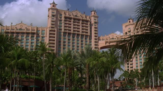 ms tu td atlantis resort hotel with pool in foreground / paradise island, bahamas - atlantis stock videos and b-roll footage