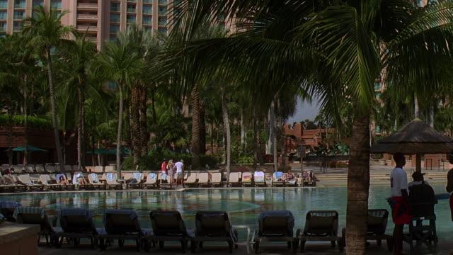 ms pan tu atlantis resort hotel with pool in foreground / paradise island, bahamas - atlantis stock videos and b-roll footage