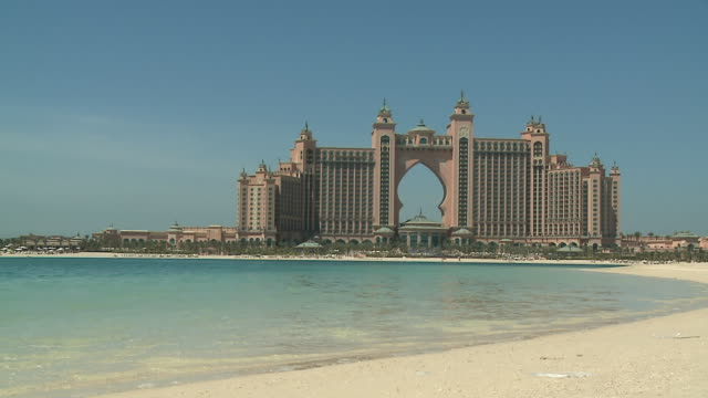 ws pan atlantis resort seen across water / dubai, united arab emirates - famous place stock videos & royalty-free footage