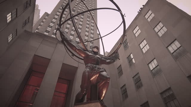 atlas bronze statue in rockefeller center with coronavirus face mask. midtown manhattan nyc. filmed during the coronavirus pandemic. dramatic low... - globe navigational equipment stock videos & royalty-free footage