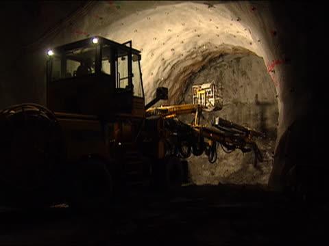 atlas copco drill rig preparing to bore section of gotthard base tunnel / faido, switzerland - tunnel stock-videos und b-roll-filmmaterial