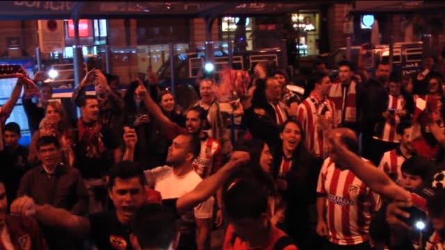 Atletico Madrid fans celebrate at Neptuno Square in Madrid Spain on May 03 2016 after their team qualified for the final after the UEFA Champions...