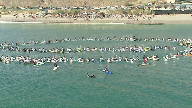 atmosphere at the a day at the beach paddle out protest at malibu beach in malibu california on october 22 2006 - malibu beach stock videos & royalty-free footage