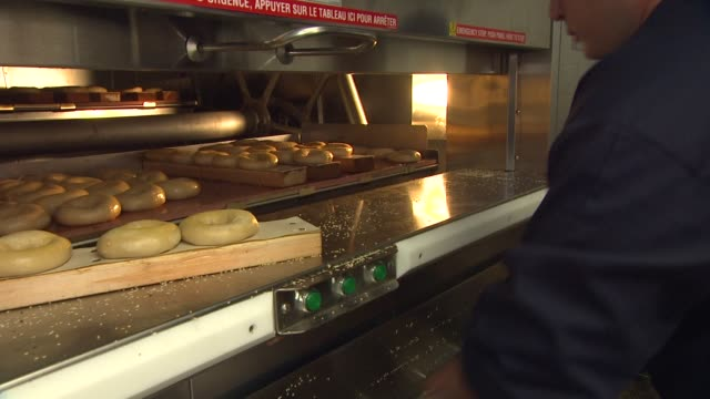 atmosphere at the larry king brings brooklyn to la with the grand opening of brooklyn water bagel at beverly hills ca - bagel stock videos & royalty-free footage