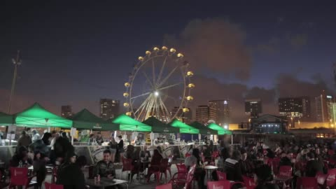 stockvideo's en b-roll-footage met atmosphere at the primavera sound music festival in barcelona, with the ferrie wheel in the background.. primavera sound festival in barcelona 2013... - festivalganger