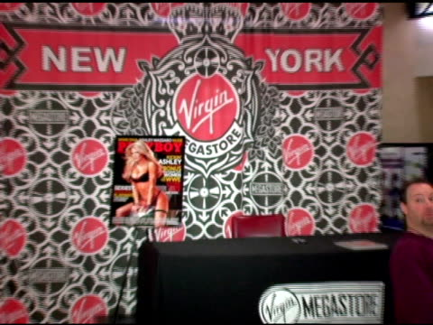 atmosphere at the wwe diva ashley massaro autographs copies of her april playboy at virgin megastore times square in new york, new york on march 8,... - megastore stock videos & royalty-free footage
