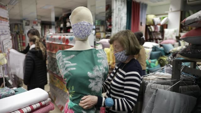 vidéos et rushes de atmosphere during the reopening of the fabric store charrière paul ets in the center of chambery fabric stores are allowed to reopen to allow every... - chiffon