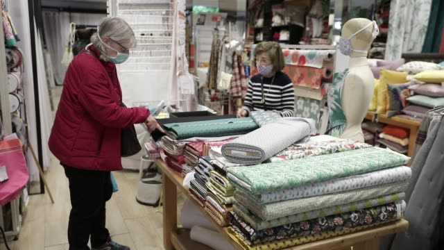 """atmosphere during the reopening of the fabric store """"charrière paul ets"""" in the center of chambery. fabric stores are allowed to reopen to """"allow... - opening stock videos & royalty-free footage"""