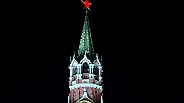 Atmosphere of intimidation against gay people ahead of Sochi 2014 Winter Olympics RUSSIA Moscow EXT / NIGHT **Music heard SOT** Spasskaya Tower on...