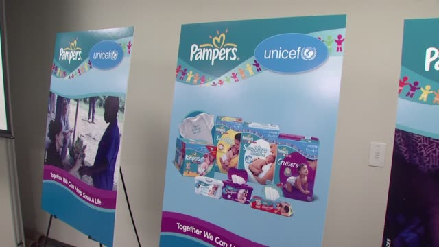 signage at the salma hayek and unicef announce 2nd wave of 'one pack = one vaccine' campaign at new york ny - salma hayek stock videos and b-roll footage