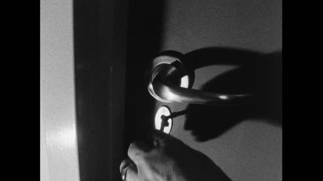 atmospheric cu key unlocking door in low lighting; 1964 - atmosphere filter stock videos & royalty-free footage