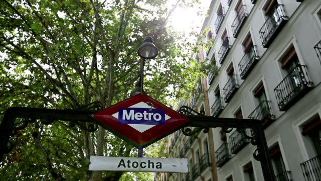 atocha railway station metro stop in madrid - railroad station stock videos & royalty-free footage