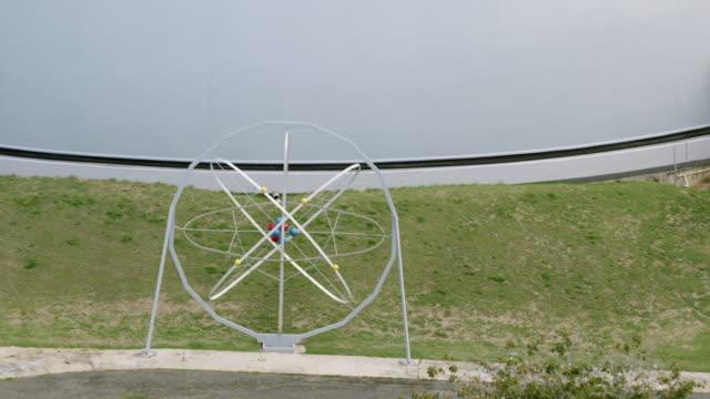 WS ZO AERIAL POV Atom sculpture in front of BONUS Nuclear Reactor / Rincon, Puerto Rico, United States
