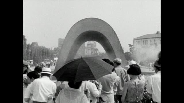 zo atomic bomb dome through hiroshima memorial; 1966 - arma nucleare video stock e b–roll