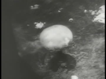 atomic bomb exploding on ground, cloud climbing. mushroom cloud top. nuclear weapon, end of wwii. - bomb stock videos & royalty-free footage
