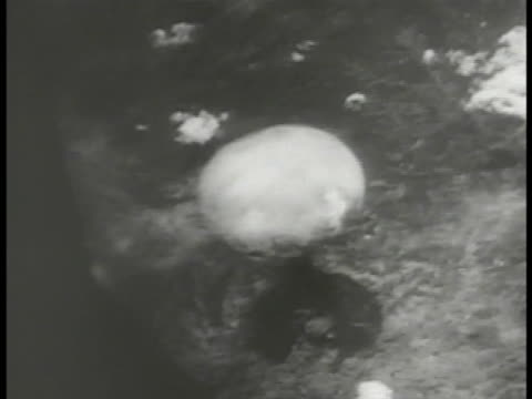 atomic bomb exploding on ground cloud climbing ws mushroom cloud top nuclear weapon end of wwii - atomic bomb stock videos & royalty-free footage