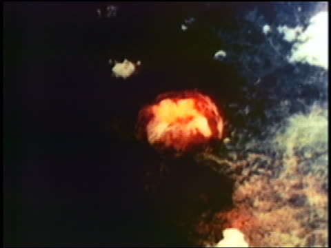vídeos de stock, filmes e b-roll de aerial atomic bomb exploding on nagasaki / documentary - 1945