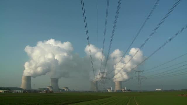 ws atomic power plant and power lines / cattenom, lorraine, france - lorraine bildbanksvideor och videomaterial från bakom kulisserna