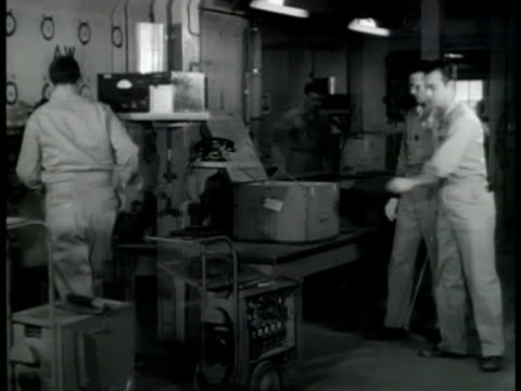 atomic workers packaging radioactive isotope in container for shipment ms geiger counter blinking ms man packaging shipment ms closing box cu tag... - oak stock videos and b-roll footage