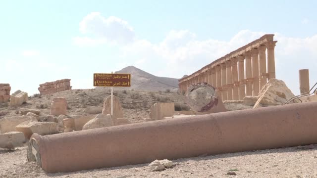 stockvideo's en b-roll-footage met atop the ruins of syria's famed palmyra theatre recently recaptured from the islamic state group teenage musicians play an old arabic favourite we're... - isis
