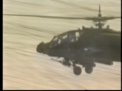 a us attack helicopter flies above the saudi arabian desert in preparation for a ground war during desert storm - (war or terrorism or election or government or illness or news event or speech or politics or politician or conflict or military or extreme weather or business or economy) and not usa video stock e b–roll