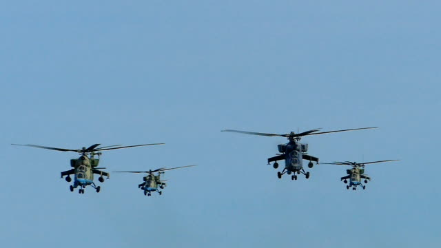 attack of modern military helicopters (slow motion) - helicopter stock videos and b-roll footage