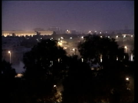 attack on iraq begins en special mark austin evening news pool iraq baghdad ext at night gv city skyline as air raid sirens heard sot gv explosion as... - iraq war stock videos and b-roll footage