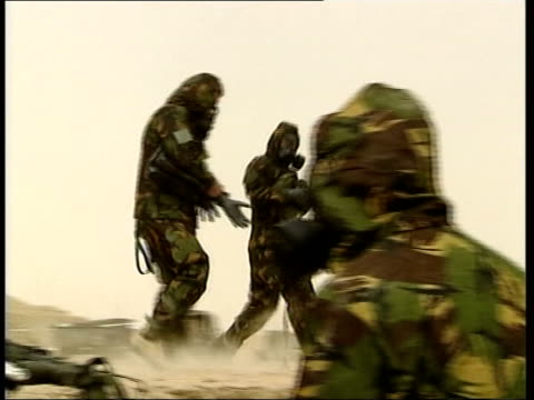 Attack on Iraq begins EN special POOL CMS British soldiers wearing NBC suits and gas masks after fears that Iraqi missiles launched into Kuwait my be...