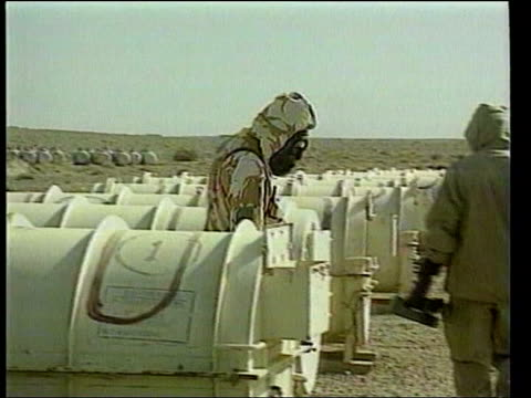 stockvideo's en b-roll-footage met attack on iraq begins ltn special lib inspectors in protective clothing and gas masks examining scud missiles gvs missiles soldier operating patriot... - raket wapen