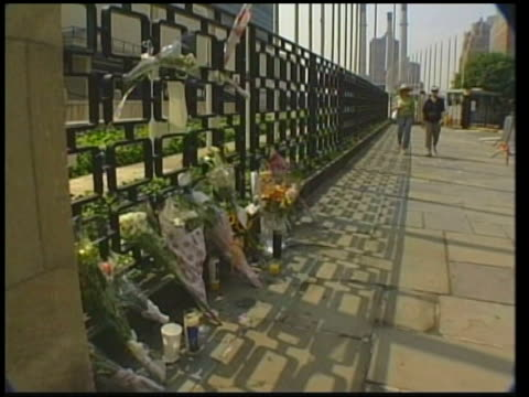 us seeks to boost security itn new york flowers left outside the united nations in tribute to people killed in baghdad cms un flag flying at halfmast... - monument stock videos & royalty-free footage