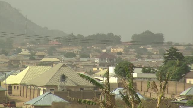 attackers in nigeria including some wearing military uniforms have killed 10 members of the same family with half the victims under the age of six... - jos nigeria stock videos & royalty-free footage