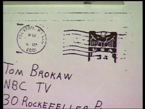 vidéos et rushes de and around the world; lib blown up photograph of envelope containing anthrax that was sent to nbc news anchor tom brokaw tilt down envelope sent to... - nbcuniversal