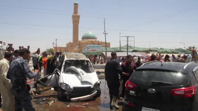 attacks killed eight people in town squares in iraq on friday including seven who died when a suicide bomber dressed in army uniform set off his car... - midday stock videos and b-roll footage