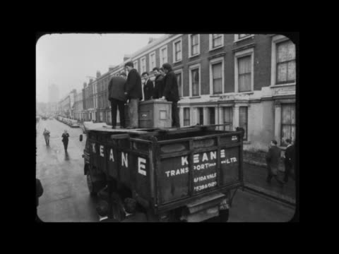 attempt being made on record for being buried alive; itn england: london: kilburn: ext mike meaney eating pull out empty coffin men at bar of pub... - pyjamas stock videos & royalty-free footage