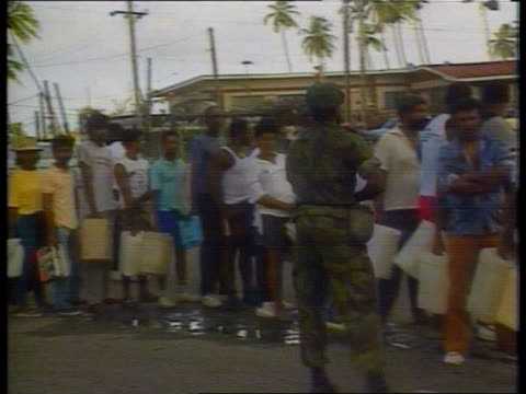 attempted coup; d) 5.40pm: trinidad: port of spain: people on street: petrol stn queue as people wait with containers: army & police patrol some in... - trinidad trinidad and tobago stock videos & royalty-free footage