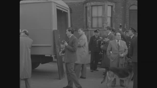 london east end turner's road vehicles and police outside scene gv i/c sof as the security van carrying with them the wounded man ms dusting for... - itv late evening bulletin stock videos and b-roll footage