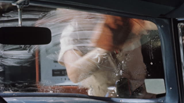 1956 cu attendant washing car windshield at phillips 66 gas station / usa - gas station attendant stock videos and b-roll footage