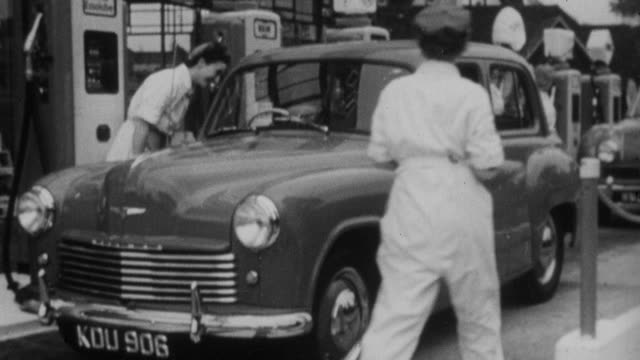 1952 montage attendants at gas stations filling cars with fuel / england - petrol stock videos & royalty-free footage