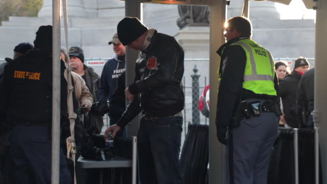 attendees are searched for weapons as they arrive for a rally organized by the virginia citizens defense league on capitol square near the state... - virginia us state stock videos & royalty-free footage