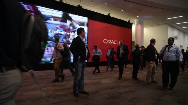 attendees arrive at oracle openworld 2017 conference in san francisco california us on monday oct 2 2017 photographer david paul morris shots wide... - oracle corporation stock-videos und b-roll-filmmaterial