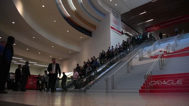 attendees arrive at oracle openworld 2017 conference via escalator and go through security in san francisco california us on monday oct 2 2017... - oracle corporation stock-videos und b-roll-filmmaterial