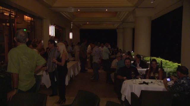 attendees at noka'oi magazine party at spago at four seasons resort at 2012 maui film festival atmosphere: attendees at noka'oi magazine party at on... - フォーシーズンズホテル点の映像素材/bロール